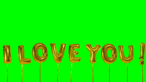 Word I love you from helium golden balloon letters floating on green screen Footage