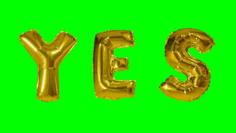Word yes from helium gold balloon letters floating on green screen Footage