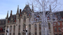 Belgium Bruges market Grote Markt with white glitter tree and provincial court GIF