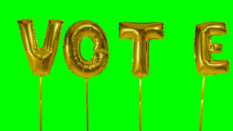 Word vote from helium golden balloon letters floating on green screen Footage