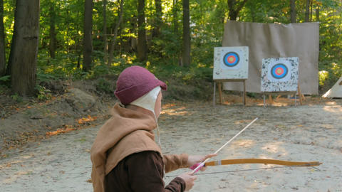 Man archer training with wooden bow Live Action