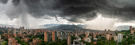 Panoramic view of two shower storms washing a city, in Colombia フォト