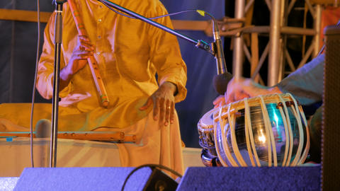 Two men playing traditional Indian tabla drums and flute GIF