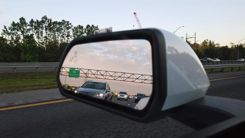 Wing Mirror Of A Car Moving On Highway GIF