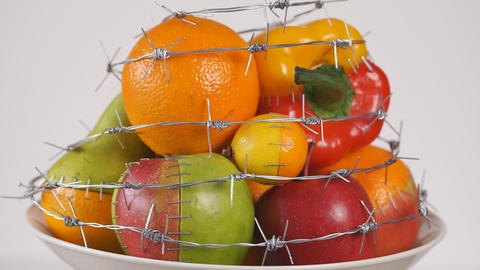 GMO foods. GMO concept genetically altered or modified food. Hybrids of fruits and vegetables Footage