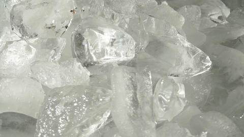 Background with crushed ice cubes, top view. Crushed ice for drinks and cocktails Footage