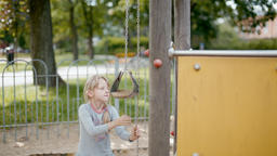 Girl is Playing with Educational Developing Equipment and Sand on the Playground Footage