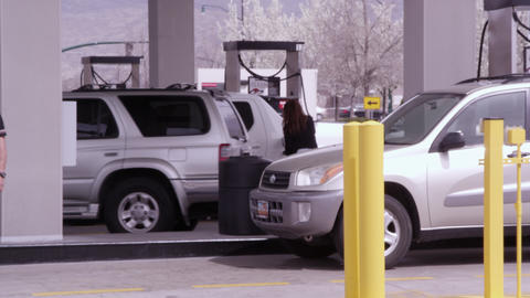 Several vehicles fueling up at gas station Footage