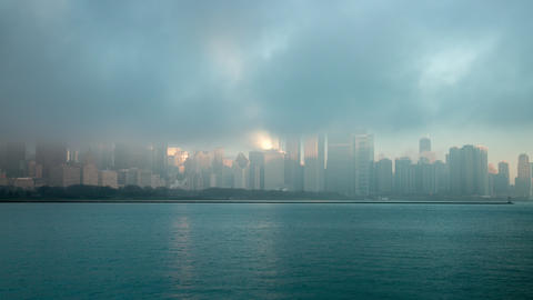 Time lapse of fog over Chicago from across the water Footage
