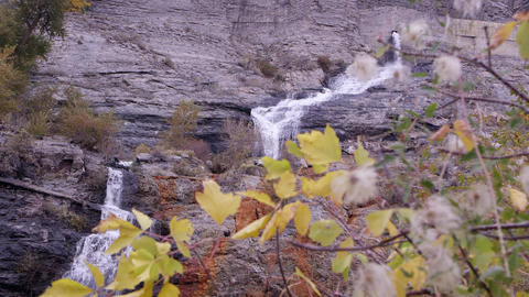 Trucking forward shot of a waterfall cascading over the rock cliff Footage
