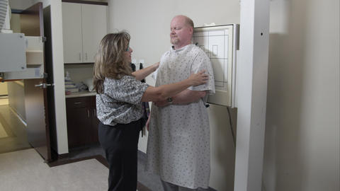 Nurse positioning man and equipment for scan Footage