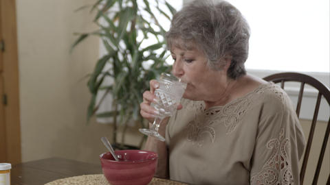 Elderly woman eating soup Live Action