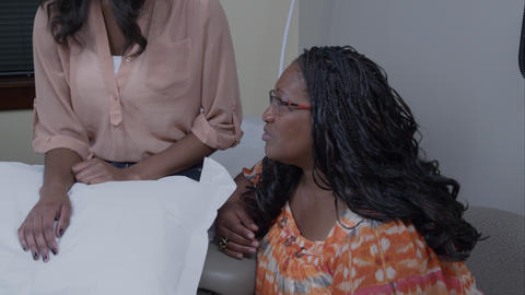 Doctor discussing x-ray with patient and patient's mother Footage