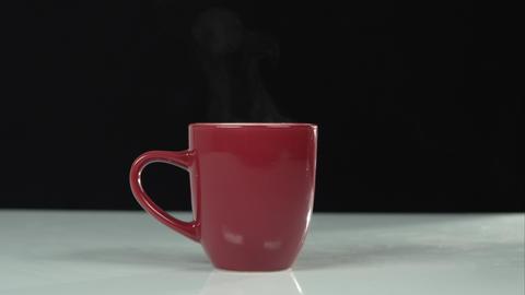 Static shot of a steaming mug Live Action