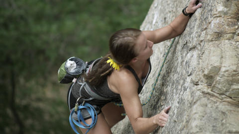 Rock climbing woman, with dreads, chalking her fingers Footage