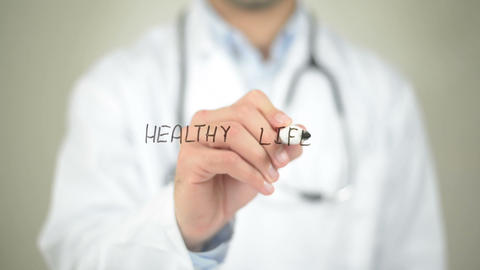 Healthy Lifestyle, Doctor writing on transparent screen Stock Video Footage