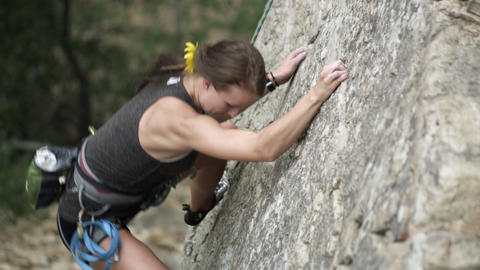 Rock climbing woman, with dreads, finding holds Footage