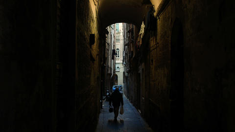 view from below towards the sky in the alleyways, typical narrow streets in the GIF