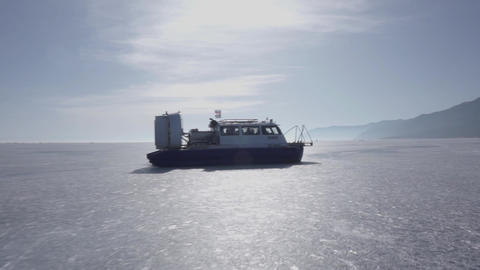 Airboat floating on the frozen lake. Aeroglisser on the frozen lake Baikal Live Action