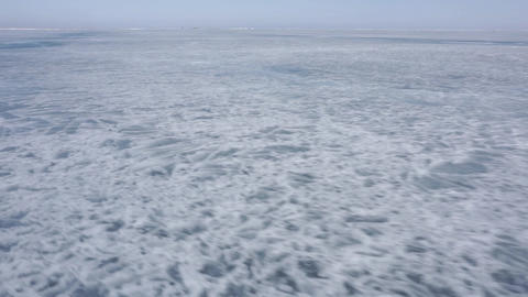 The ice of a frozen lake. Lake Baikal Live Action
