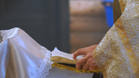 The book is in the hands of a priest ビデオ