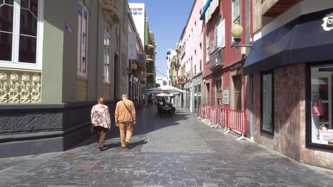 Las Palmas de Gran Canaria, Spain - February 25, 2019 : walking in a street in Live Action