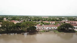Aerial video of a drone flying over the river overlooking the riverside colonial houses of the town Footage