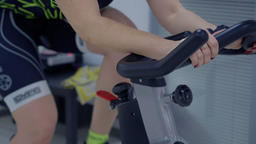 Sport woman training on exercise bike while cardio gym in fitness club GIF