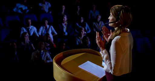 Caucasian businesswoman speaking in business seminar in auditorium 4k Live Action