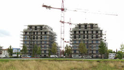 Residential Buildings With Scaffolding and Construction Crane from Field Live Action