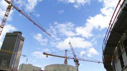 Sunny Cloudscape and Construction Cranes Live Action