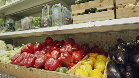 Large variety of vegetables and fruits on a supermarket shelves Live Action
