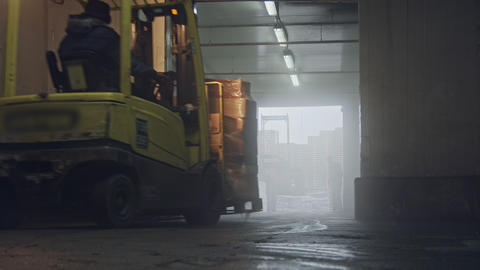 Forklift lifting pallets in a dark cooled warehouse Footage