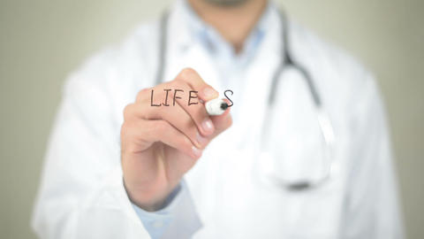 Life Saving Drugs, Doctor Writing On Transparent Screen stock footage