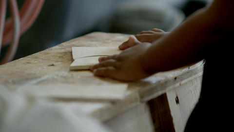 Young girl playing with wood pieces in the wood shop Footage