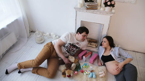 Pregnant woman and her husband and newborn clothing Live Action