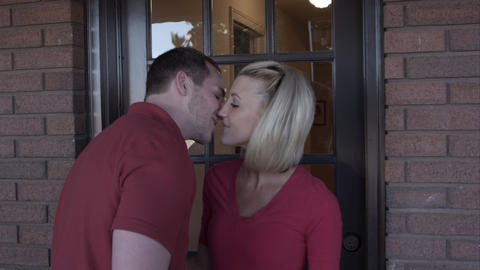 Man leaves woman at the door with a kiss Live Action