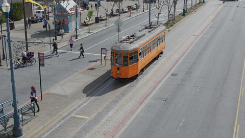 A San Francisco Municipal train unloads passengers and leaves Footage