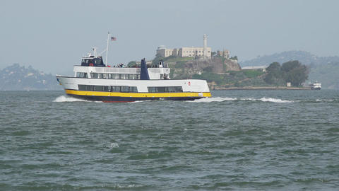 A ferry floats by Alcatraz Footage