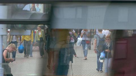 Crowd of People Walking Along Busy Street in Summertime Footage