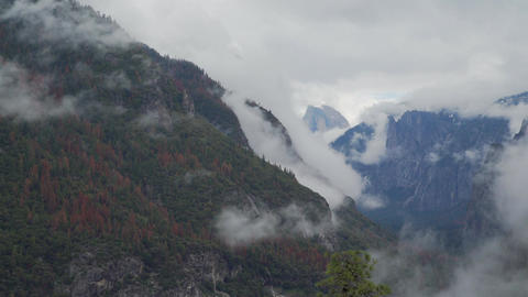 Time lapse of wispy clouds blowing through the Yosemite valley Footage
