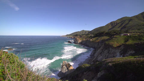 Dramatic crane shot of of morning rocky Big Sur cove Footage