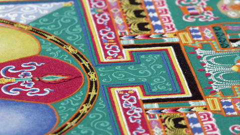 Panning, low angle of a colorful sand mandala Footage