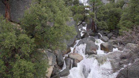 A swollen spring river crashes over rocks in Yosemite Footage