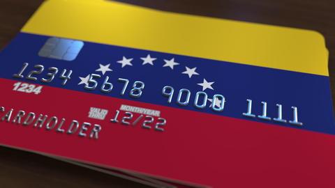 Plastic bank card featuring flag of Venezuela. Venezuelan national banking Fotografía