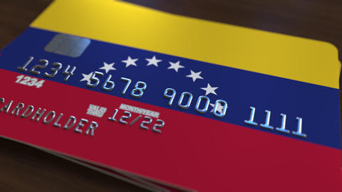Plastic bank card featuring flag of Venezuela. Venezuelan national banking Footage