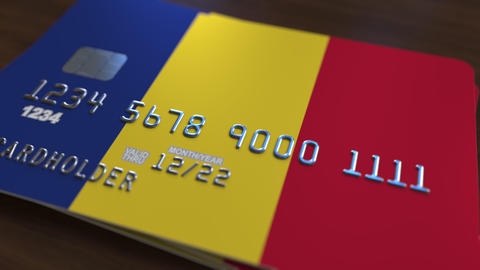Plastic bank card featuring flag of Romania. Romanian national banking system Footage