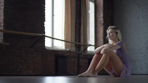 Depression and fatigue of a dancer who sits on the floor Footage