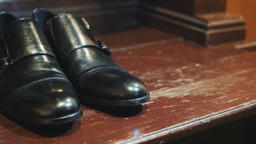 Men's shoes. Close up of black leather men's shoes. Stylish black shoes for the Footage