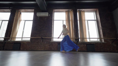 Young dance makes emotional run and twine jump in slow motion Footage